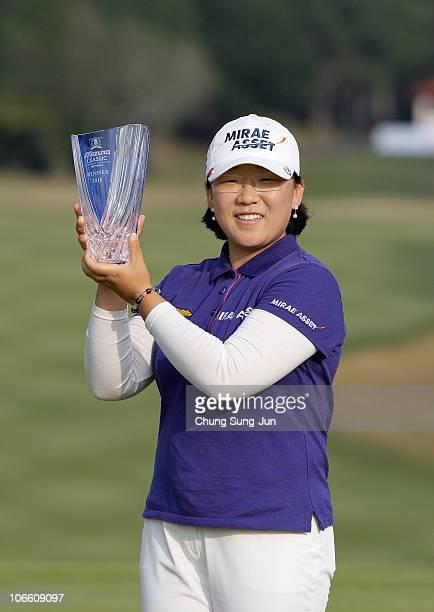 JiYai Shin of South Korea poses with the tournament trophy during the final round of the Mizuno Classic at Kintetsu Kashikojima Country Club on...
