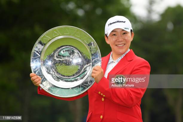 Jiyai Shin of South Korea poses with the trophy after the award ceremony following the final round of the Earth Mondamin Cup at the Camellia Hills...