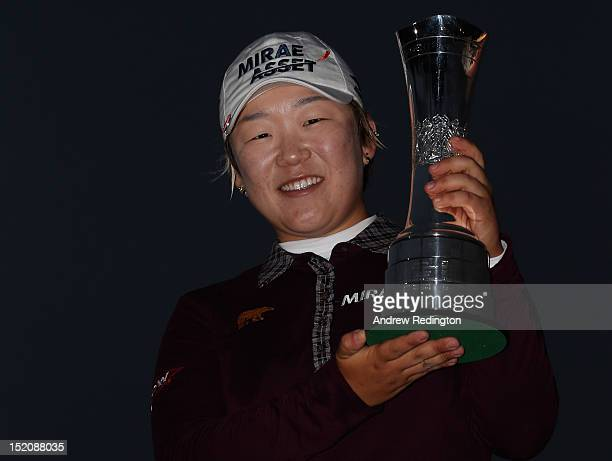 Jiyai Shin of South Korea poses with the trophy after winning the Ricoh Women's British Open at Royal Liverpool Golf Club on September 16 2012 in...