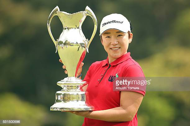 Jiyai Shin of South Korea poses with the trophy after winning the HokennoMadoguchi Ladies at the Fukuoka Country Club Ishino Course on May 15 2016 in...