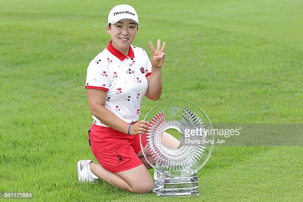 Jiyai Shin of South Korea poses with winner's trophy during a ceremony following the Nichirei Ladies at the Sodegaura Country Club Shinsode Course on...