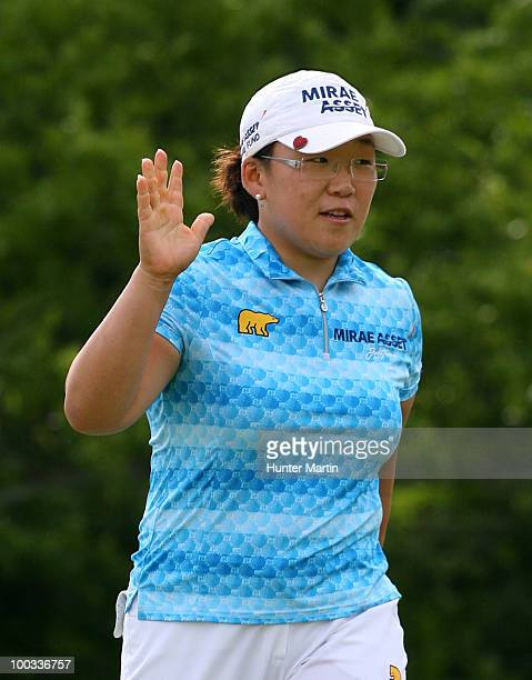 Jiyai Shin of South Korea waves to the crowd after making her birdie putt on the sixteenth hole during the third round of the Sybase Match Play...