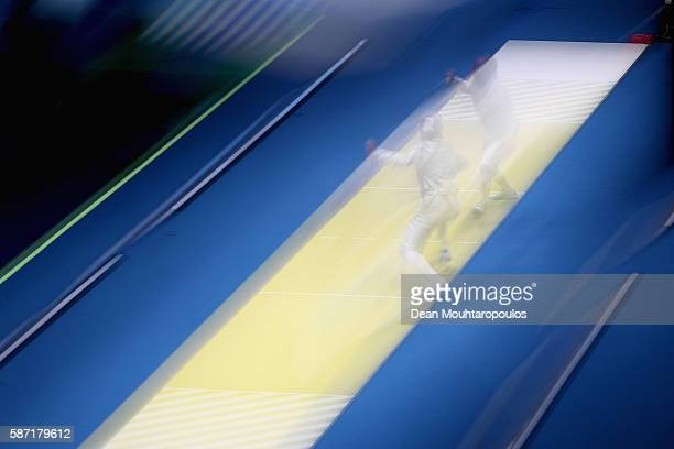 Jiyeon Kim of Korea and Loreta Gulotta of Italy compete during the Women's Individual Sabre on Day 3 of the Rio 2016 Olympic Games at Carioca Arena 3...