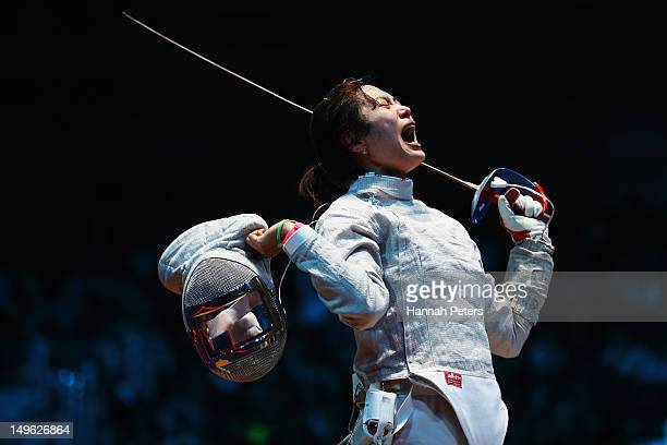 Jiyeon Kim of Korea celebrates after beating Vassiliki Vougiouka of Greece in the Women's Sabre Individual quarterfinal match on Day 5 of the London...