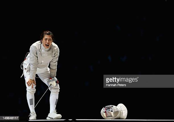 Jiyeon Kim of Korea celebrates victory in the Women's Sabre Individual Fencing Gold medal match against Sofya Velikaya of Russia on Day 5 of the...