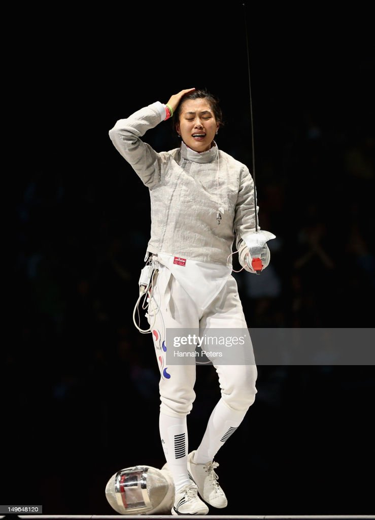 Jiyeon Kim of Korea celebrates victory in the Women's Sabre Individual Fencing Gold medal match against Sofya Velikaya of Russia on Day 5 of the London 2012 Olympic Games at ExCeL on August 1, 2012 in London, England.
