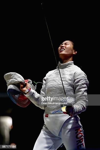 Jiyeon Kim of Korea celebrates victory over Thi Le Dung Nguyen of Vietnam during the Women's Individual Sabre on Day 3 of the Rio 2016 Olympic Games...
