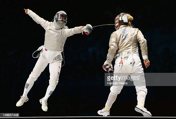 Jiyeon Kim of Korea competes in the Women's Sabre Individual Fencing Semi Final against Mariel Zagunis of the United States on Day 5 of the London...