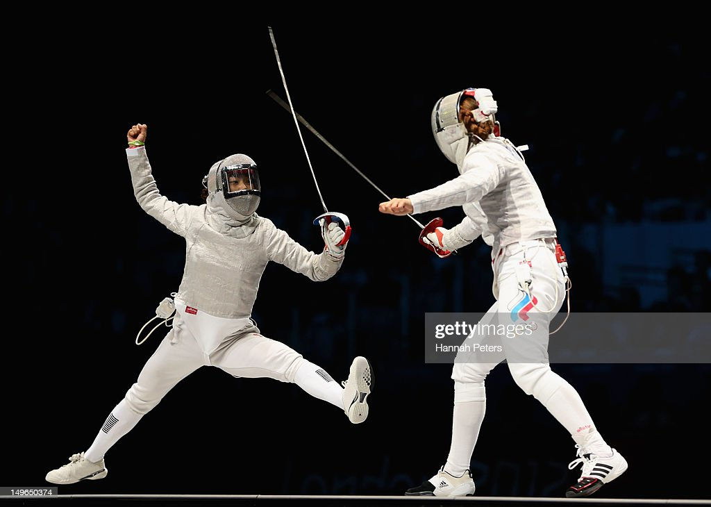 Jiyeon Kim of Korea competes in the Women's Sabre Individual Fencing Gold medal match against Sofya Velikaya of Russia on Day 5 of the London 2012 Olympic Games at ExCeL on August 1, 2012 in London, England.