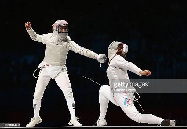 Jiyeon Kim of Korea competes in the Women's Sabre Individual Fencing Gold medal match against Sofya Velikaya of Russia on Day 5 of the London 2012...