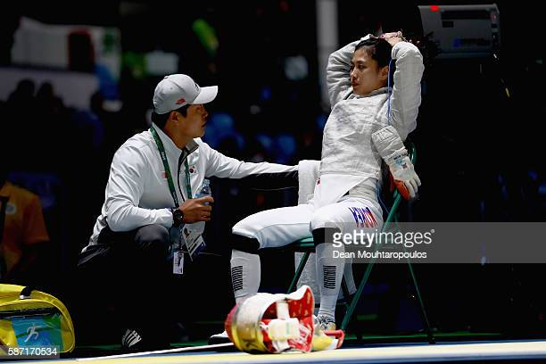 Jiyeon Kim of Korea talks with her coach during the Women's Individual Sabre on Day 3 of the Rio 2016 Olympic Games at Carioca Arena 3 on August 8...