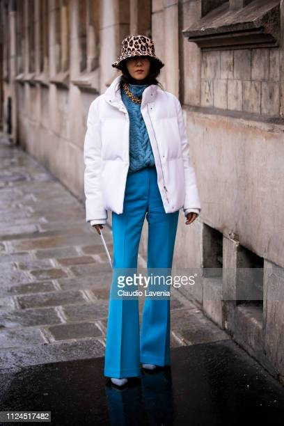 Jiyoung Kim wearing a teal jumper teal trousers white jacket and leopard print hat is seen outside Maison Margiela show during Paris Fashion Week...