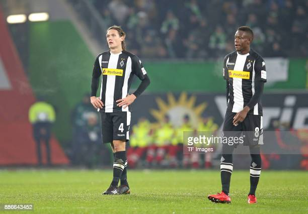 JJannik Vestergaard of Borussia Moenchengladbach and Denis Zakaria Lako Lado of Borussia Moenchengladbach looks dejected during the Bundesliga match...
