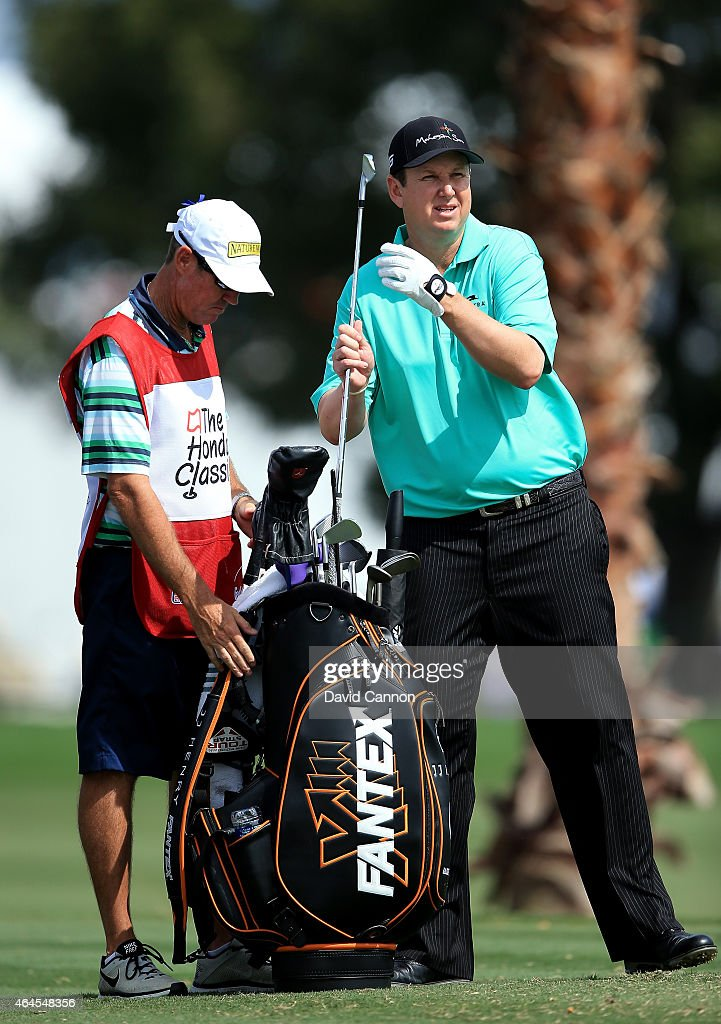 Henry of the USA chooses his club for his tee shot on the par 3, fifth hole during the first round of The Honda Classic on the Champions Course at the PGA National Resort and Spa on February 26, 2015 in Palm Beach Gardens, Florida.