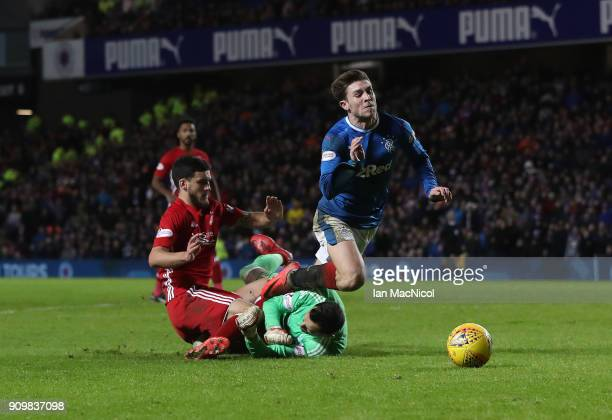JJoe Lewis of Aberdeen brings down Josh Windass of Rangers during the Ladbrokes Scottish Premiership match between Rangers and Aberdeen at Ibrox...