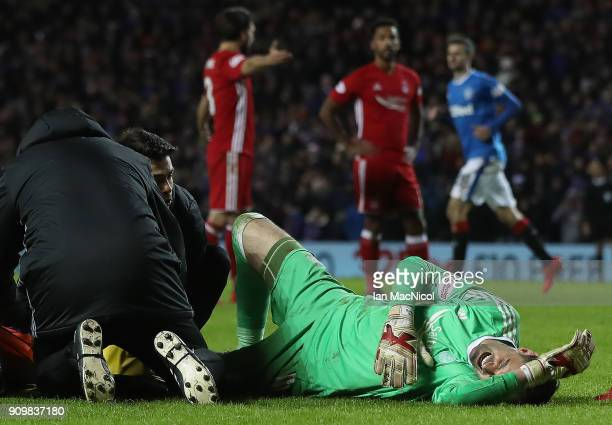 JJoe Lewis of Aberdeen receives treatment after he brings down Josh Windass of Rangers during the Ladbrokes Scottish Premiership match between...
