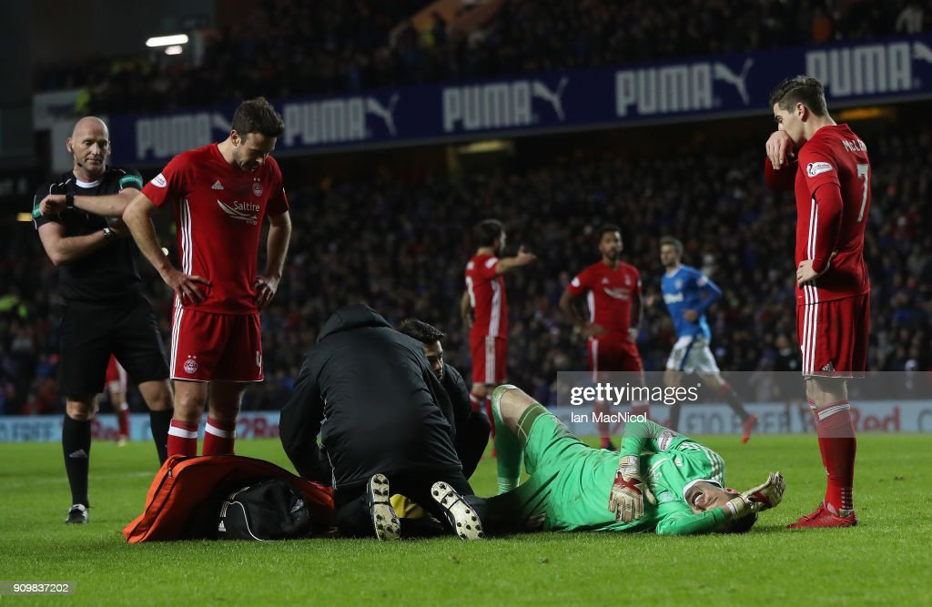 JJoe Lewis of Aberdeen receives treatment after he brings down Josh Windass of Rangers during the Ladbrokes Scottish Premiership match between Rangers and Aberdeen at Ibrox Stadium on January 24, 2018 in Glasgow, Scotland.