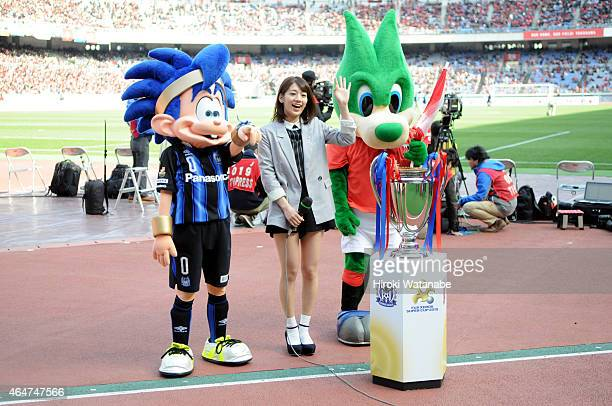 League female manager Miki Sato and mascots of Gamba Osaka and Urawa Red Diamonds are seen prior to the FUJI XEROX SUPER CUP 2015 match between Gamba...