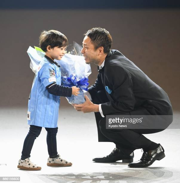 JLeague Player of the Year Yu Kobayashi receives flowers from his son Yuito during an award ceremony at Yokohama Arena on Dec 5 2017 ==Kyodo