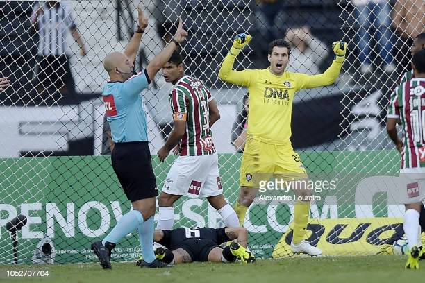 Júlio César of Fluminense celebrates a penalty lost by Fabio Santos of AtleticoMG during the match between Fluminense and AtleticoMG as part of...