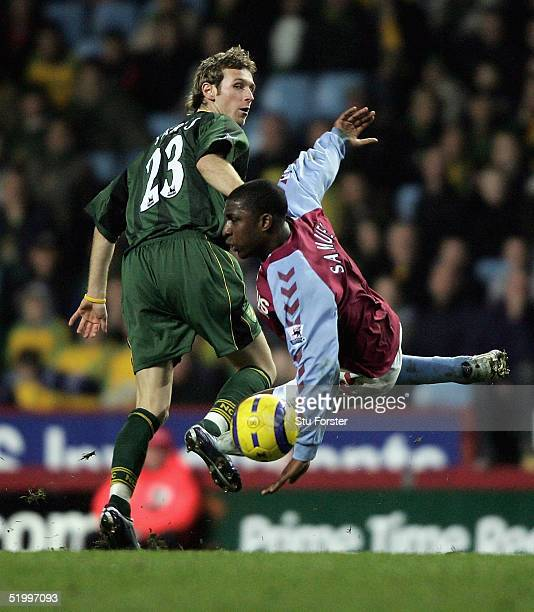 Jlloyd Samuel is shoved to the ground by Ryan Jarvis of Norwich during the Barclays Premiership match between Aston Villa and Norwich City at Villa...