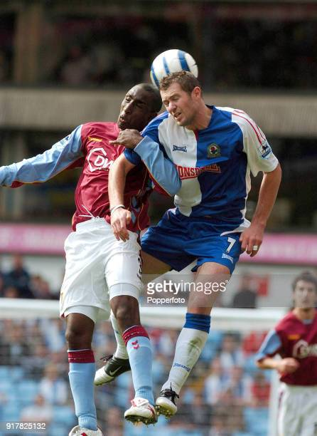 Jlloyd Samuel of Aston Villa and Brett Emerton of Blackburn Rovers in action during the FA Barclays Premiership match between Aston Villa and...