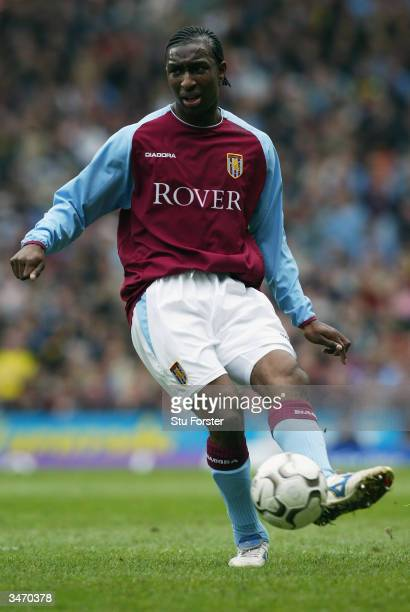 Jlloyd Samuel of Aston Villa passes the ball during the FA Barclaycard Premiership match between Aston Villa and Chelsea at Villa Park on April 12...