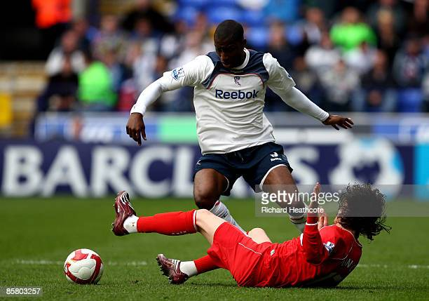 Jlloyd Samuel of Bolton battles with Tuncay of Boro during the Barclays Premier League match between Bolton Wanderers and Middlesbrough at The Reebok...