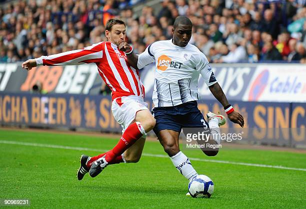 Jlloyd Samuel of Bolton is tackled by Rory Delap of Stoke during the Barclays Premier League match between Bolton Wanderers and Stoke City at the...