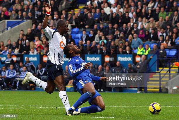 Jlloyd Samuel of Bolton Wanderers brings down Didier Drogba of Chelsea to concede a penalty during the Barclays Premier League match between Bolton...