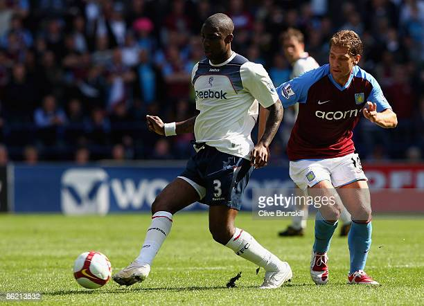 Jlloyd Samuel of Bolton Wanderers clears the ball from Stiliyan Petrov of Aston Villa during the Barclays Premier League match between Bolton...