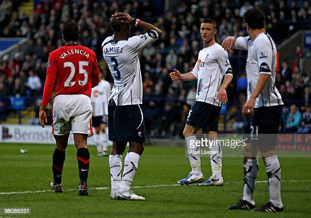Jlloyd Samuel of Bolton Wanderers reacts after scoring an own goal during the Barclays Premier League match between Bolton Wanderers and Manchester...
