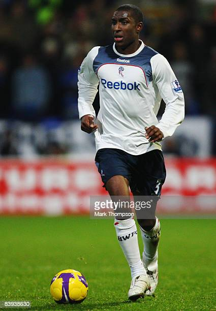 Jlloyd Samuel of Bolton Wanderers runs with the ball during the Barclays Premier League match between Bolton Wanderers and Chelsea at the Reebok...