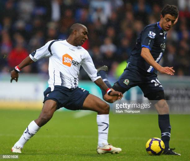 Jlloyd Samuel of Bolton Wanderers tangles with Franco Di Santo of Blackburn Rovers during the Barclays Premier League match between Bolton Wanderers...