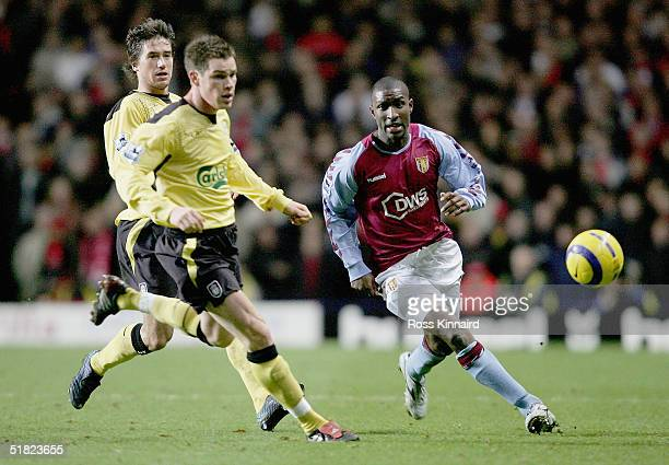 Jlloyd Samuel Villa is challenged by Steve Finnan of Liverpool during the Barclays Premiership match between Aston Villa and Liverpool at the Villa...