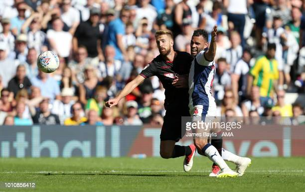 JMark Beevers of Bolton Wanderers and Hal RobsonKanu of West Bromwich Albion during the Sky Bet Championship match between West Bromwich Albion and...