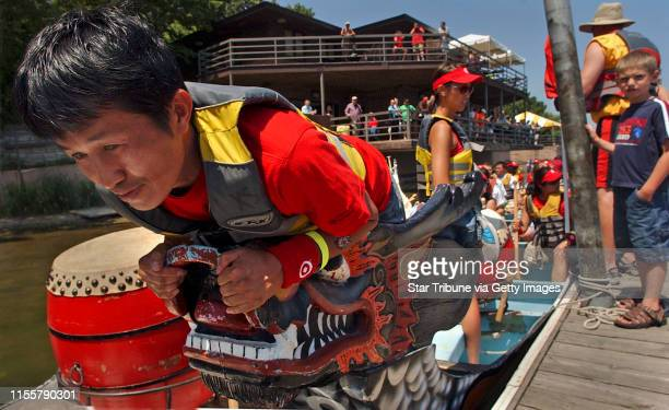 MCLEISTER ¥ jmcleister@startribunecom Lake PhalenMnSatJuly 8 2006 Pheng Vang of St Paul practices being the flag man for his dragon boat crew before...