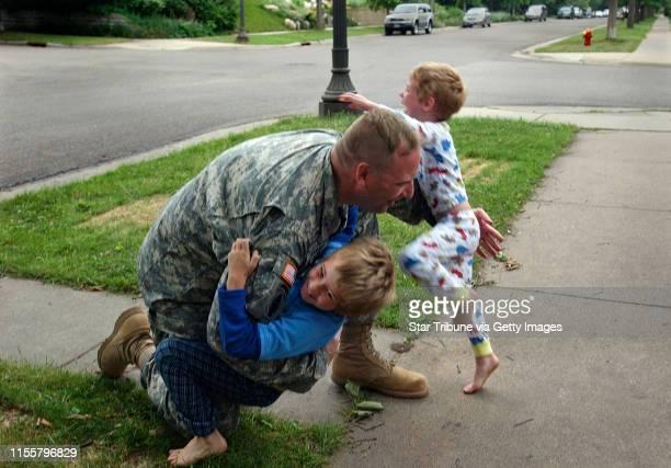 MCLEISTER ¥ jmcleister@startribunecom St PaulMnSatJune 23 2007Chief Warrant Officer RonMichael Pellant gathers up sevenyearold Max and fouryearold...