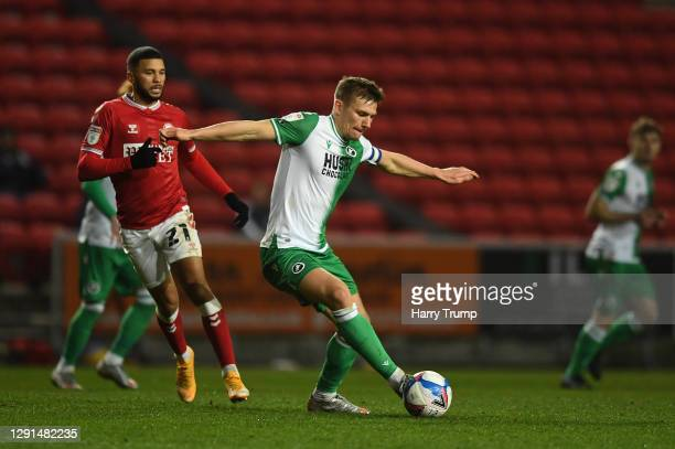 Jón Daði Böðvarsson of Millwall looks to break past Nahki Wells of Bristol City during the Sky Bet Championship match between Bristol City and...