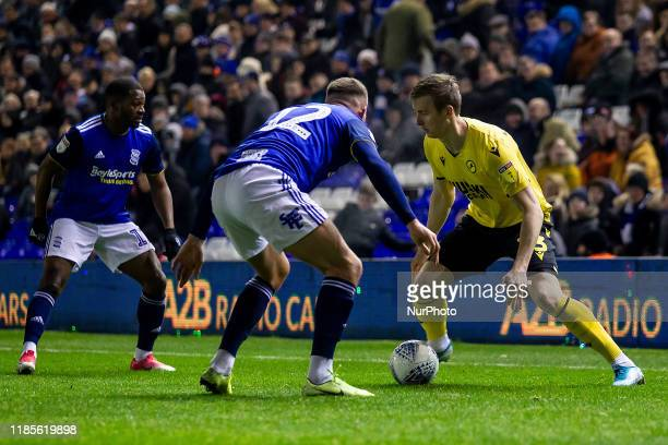 Jn Dai Bvarsson of Millwall takes on Jrmie Bela and Harlee Dean of Birmingham City during the Sky Bet Championship match between Birmingham City and...