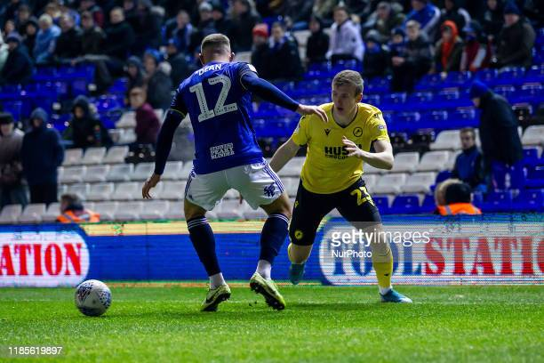 Jn Dai Bvarsson of Millwall tries to go round Harlee Dean of Birmingham City during the Sky Bet Championship match between Birmingham City and...