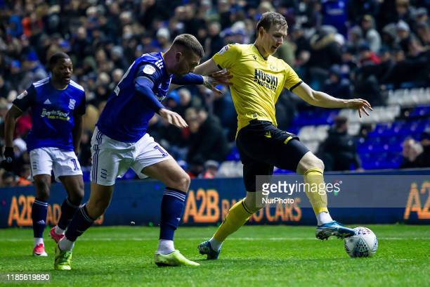 Jn Dai Bvarsson of Millwall trying to hold on to the ball under pressure from Harlee Dean of Birmingham City during the Sky Bet Championship match...