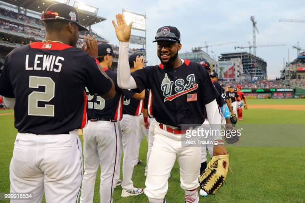 Jo Adell of Team USA celebrates with teammates after Team USA defeated the World Team in the SiriusXM All-Star Futures Game at Nationals Park on...