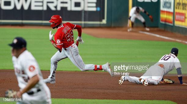 Jo Adell of the Los Angeles Angels doubles in a run in the first inning against the Houston Astros during game two of a doubleheader at Minute Maid...
