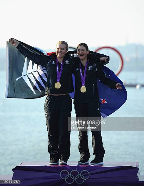 Jo Aleh and Olivia Powrie of New Zealand celebrate finishing first and winning gold medal in the 470 Women's Class Sailing on Day 14 of the London...