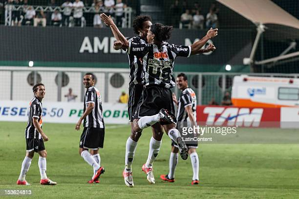 Jo and Ronaldinho Gaucho of Atlético MG celebrate a scored goal during a match between Atlético MG and Figueirense as part of the Brazilian...