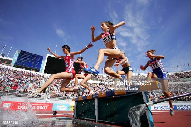 Jo Ankier of Great Britain and Cristina Monteiro Ines of Portugal compete during the heats of the women's 3000 Metres Steeplechase at the 10th IAAF...