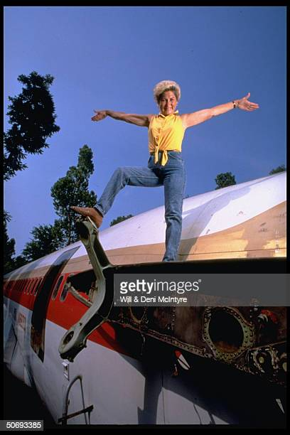 Jo Ann Ussery posing on Boeing 727 fuselage which she converted into 3 bedroom home