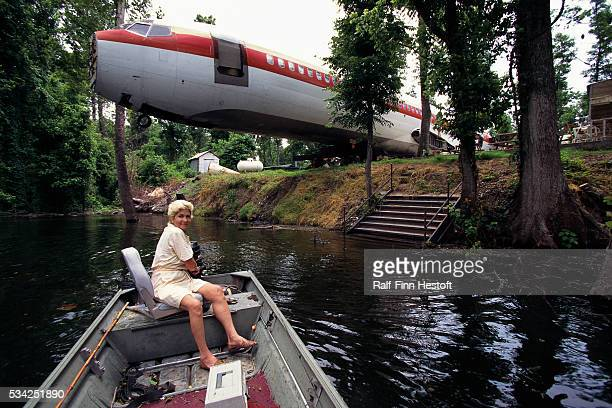 Jo Ann Ussery steers a boat on a pond outside her converted Boeing 727 Rather than buying a mobile home Ussery purchased an old Boeing 727 for $2000...