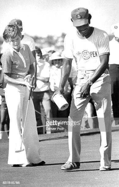 Jo Ann Washam and Caddy Ernest Wright who had on 18th Green Credit Denver Post
